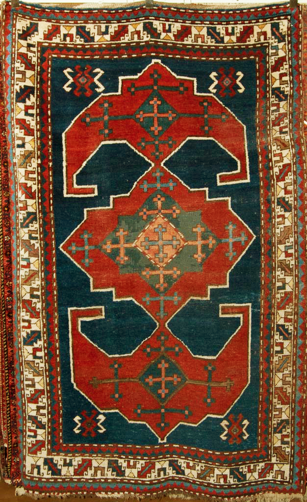 "Antique Kazak Rug Big anchors each side of the medallion. Woven in Armenia. Ca 1890. Hand made of natural wool and dyes. 6'6"" x 4'2"""