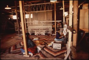 Weavers creating Native American rugs