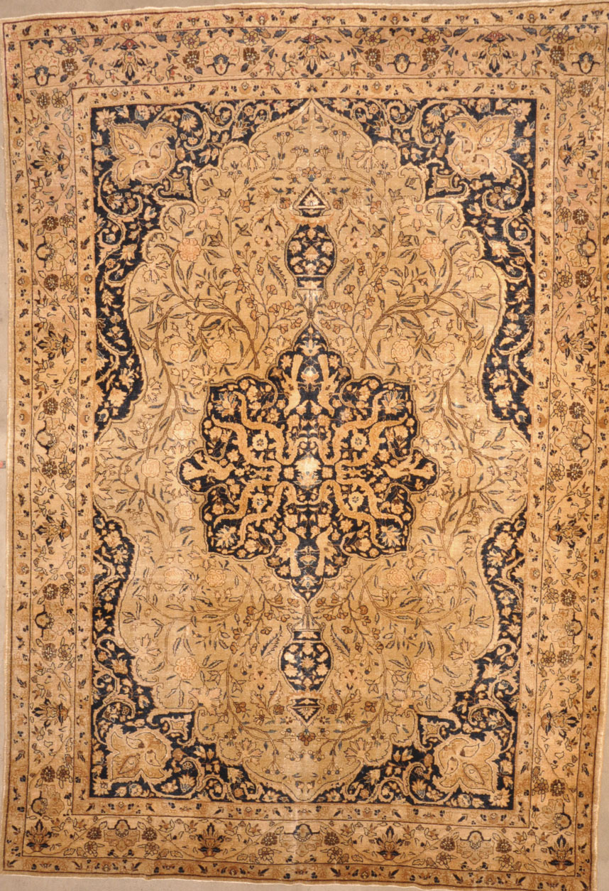 Antique Tabriz rugs are distinguished by their excellent weave and by their remarkable adherence to the classical traditions of antique Persian rug design.