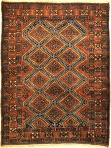 An antique Persian Afshar rug featuring a diamond pattern. A piece of genuine original woven carpet art sold by the Santa Barbara Design Center.