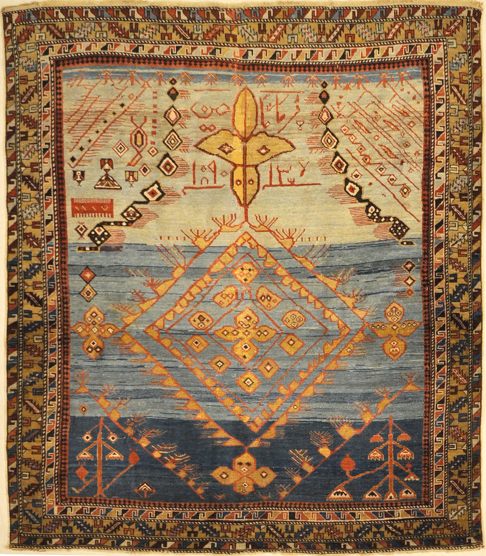 Best Caucasian Shirvan Prayer rug in the world RUGOHOLIC Rug. A piece of genuine authentic woven carpet art sold at Santa Barbara Design Center Rugs and More.