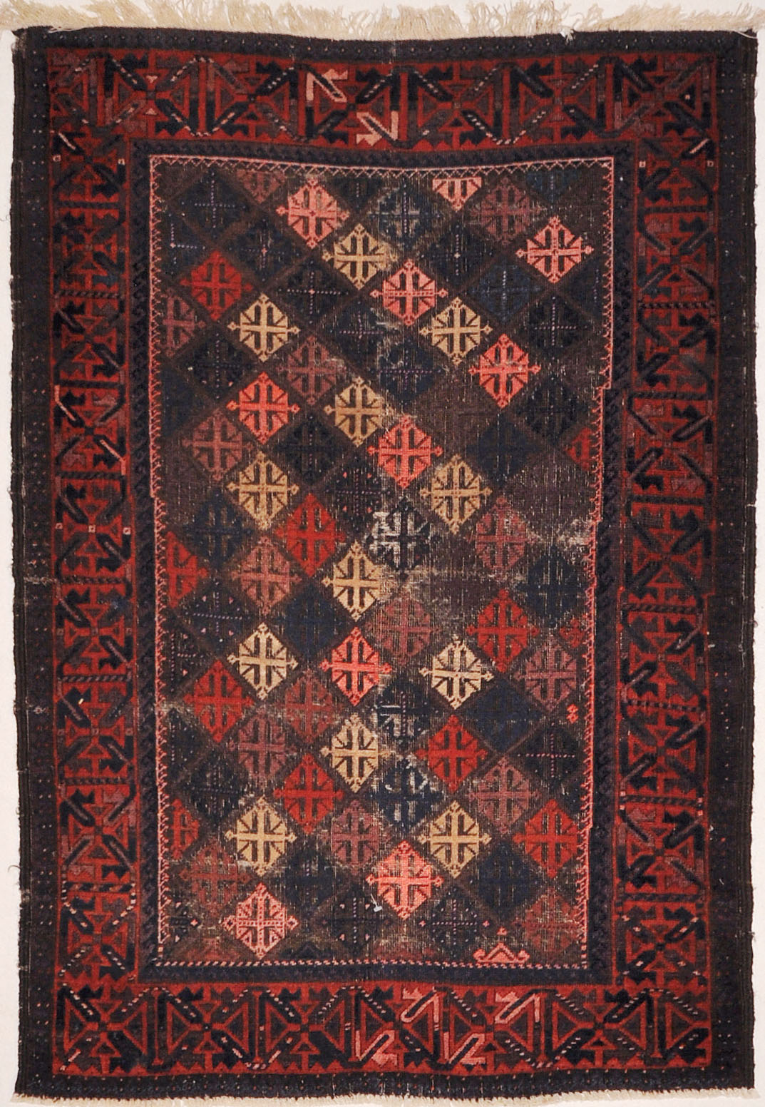 Antique Original Afghani Baluch Multicolor Diamonds A piece of genuine woven carpet art sold at Santa Barbara Design Center.