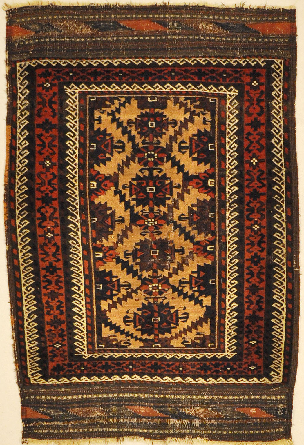Antique Camelhair Persian Beluch Circa 1900s. A piece of genuine and authentic woven carpet art from Santa Barbara Design Center Rugs and More.