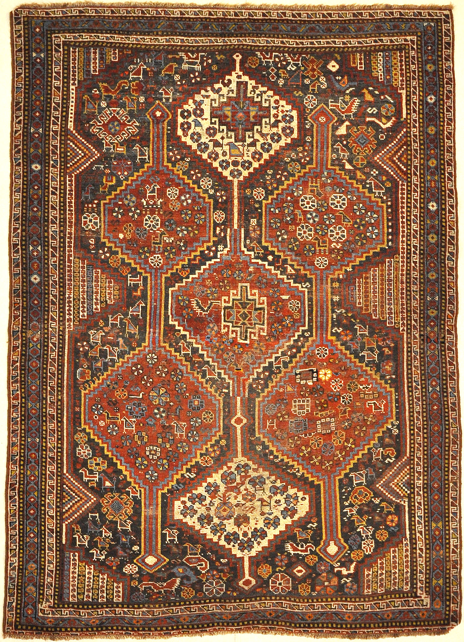 Antique Persian Khamseh Chicken Rug. A piece of genuine woven carpet art sold by Santa Barbara Design Center Rugs and More.