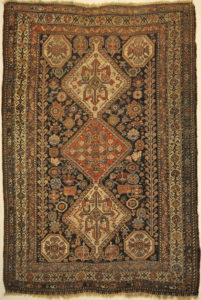 Antique Persian Qashqai featuring Tribal Flowers. A piece of genuine handwoven carpet art sold by Santa Barbara Design Center Rugs and More.