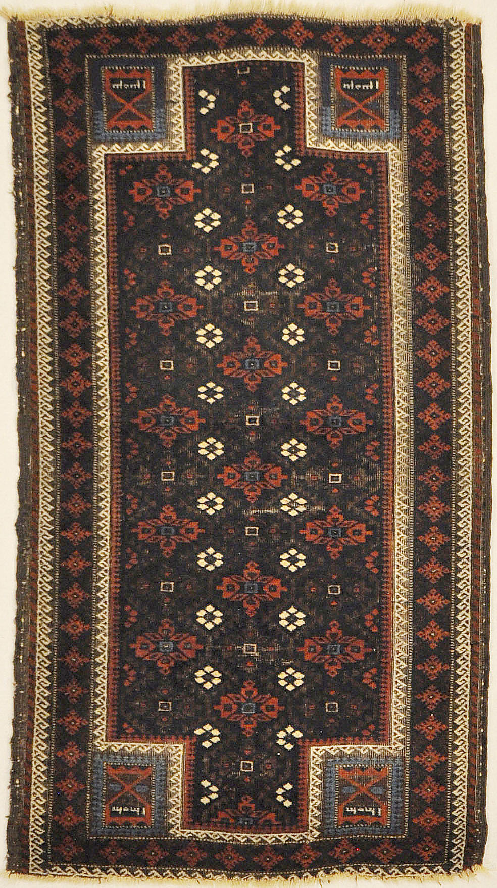 An antique and original burial Baluch dated rug. Dated on all four corners. Used as a casket covering. Sold by Santa Barbara Design Center.