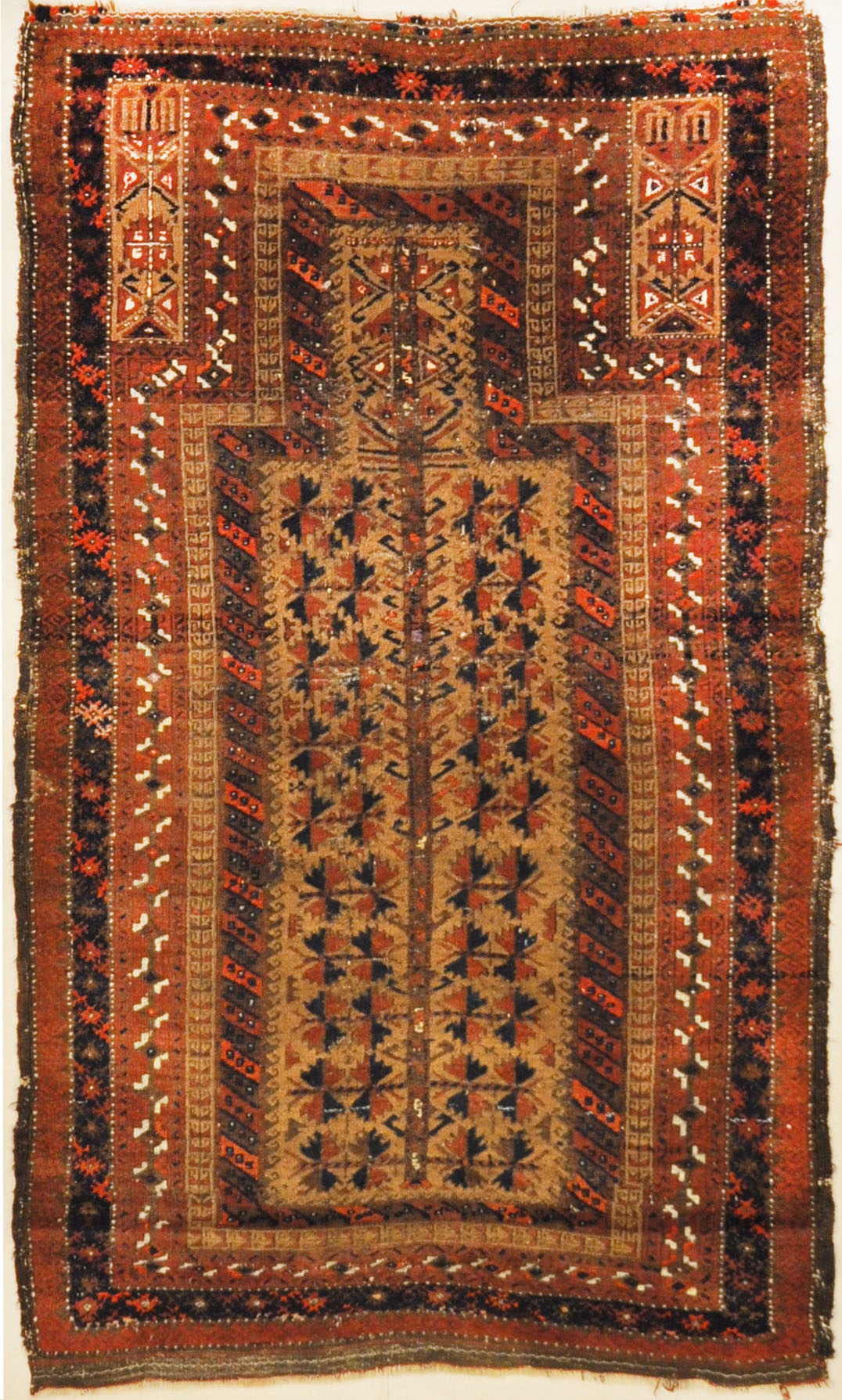 An antique, original Persian Baluch rug. A piece of genuine and authentic carpet art sold at Santa Barbara Design Center. Rugs and More.