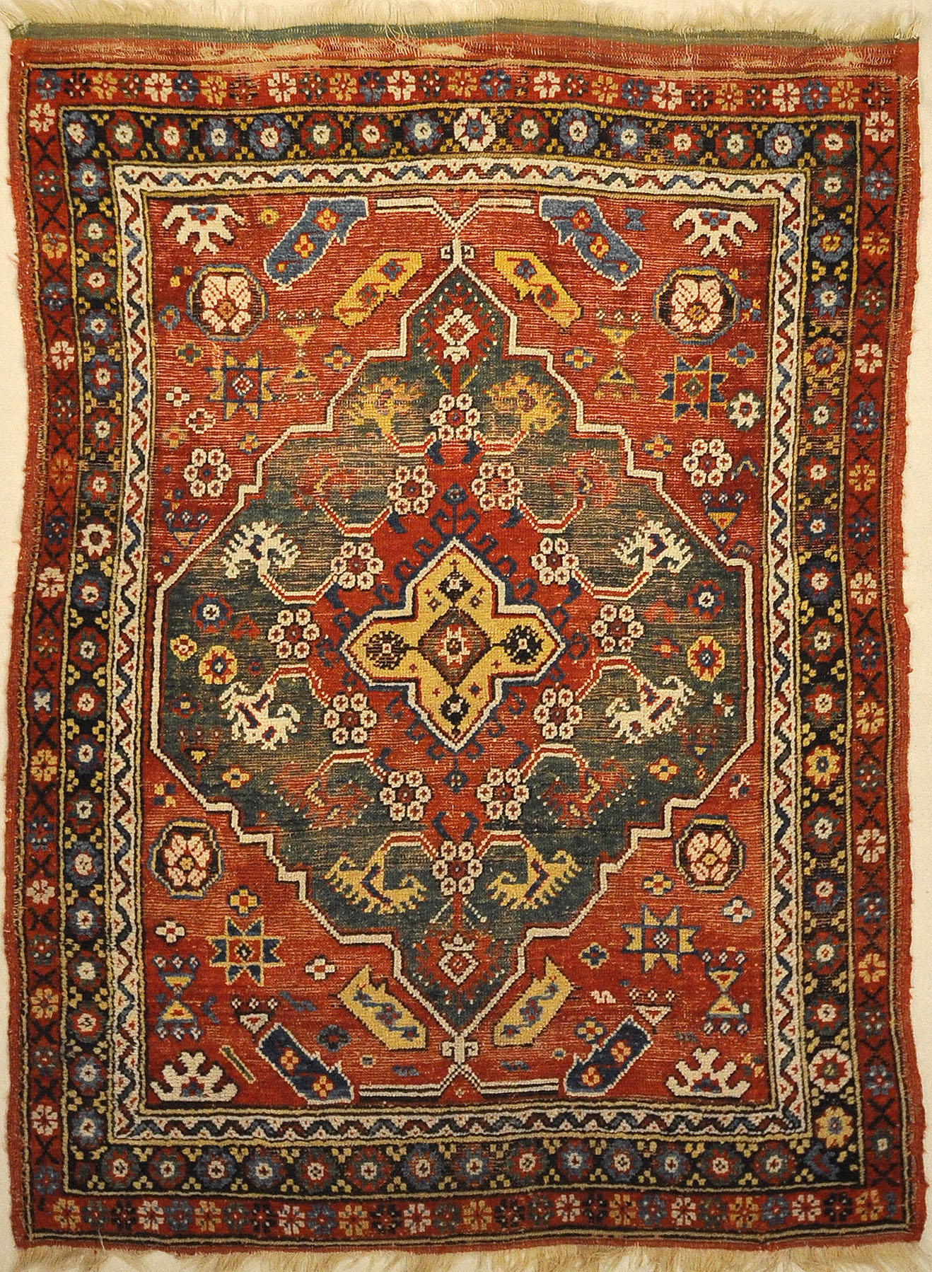 Antique Turkish Bergama Rug. A piece of genuine woven carpet art sold by the Santa Barbara Design Center and Rugs and More.