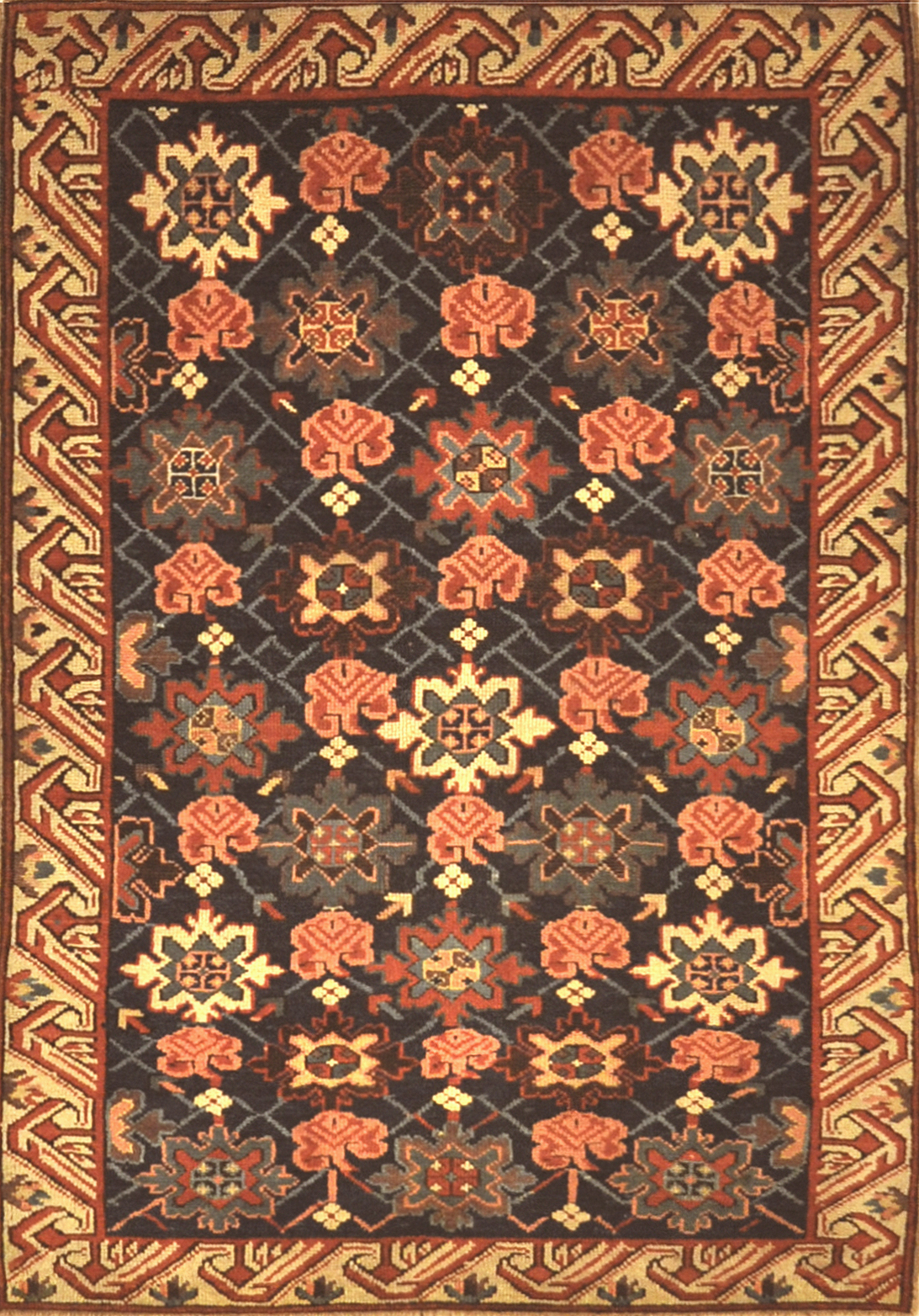 Antique Seichur Kuba Western Flowers Rug. A piece of genuine authentic antique woven carpet art sold by the Santa Barbara Design Center, Rugs and More.