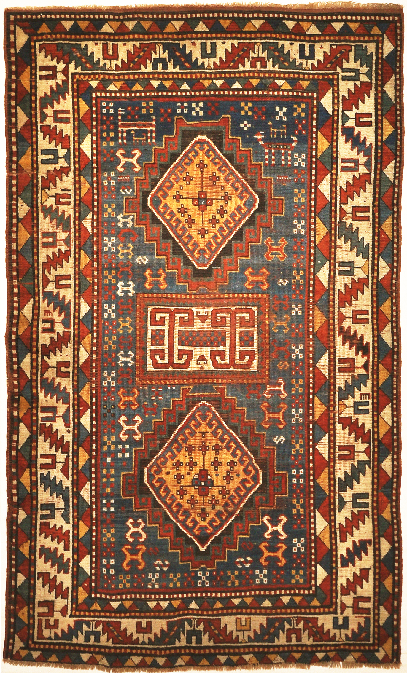 Good Quality Antique Kazak Rug from Early 19th Century. A piece of genuine authentic antique woven carpet art sold by Santa Barbara Design Center.