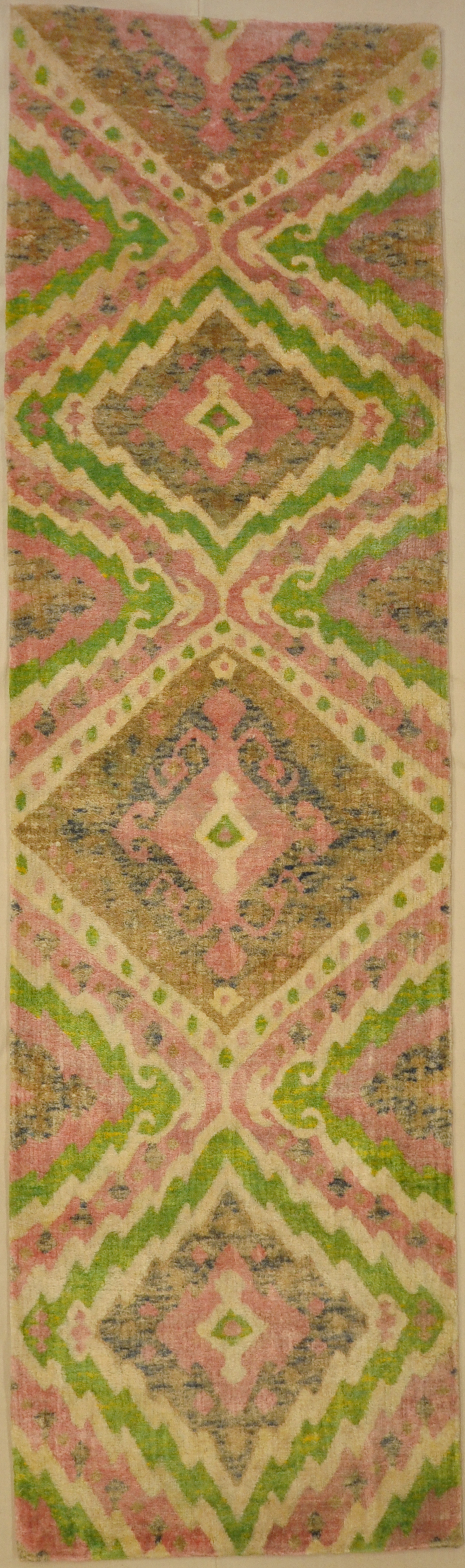 Lovely Patterned Green and Pink Runner. A piece of genuine woven authentic carpet art sold by Santa Barbara Design Center, Rugs and More.