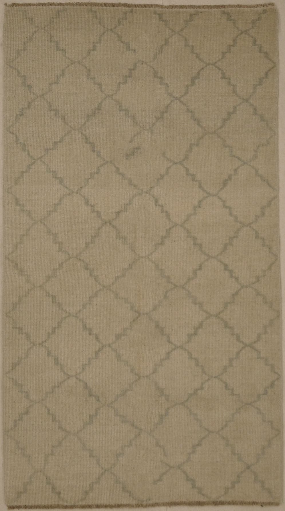 Blue and Beige Modern Trellised Rug. A piece of genuine woven carpet art sold by the Santa Barbara Design Center, Rugs and More.