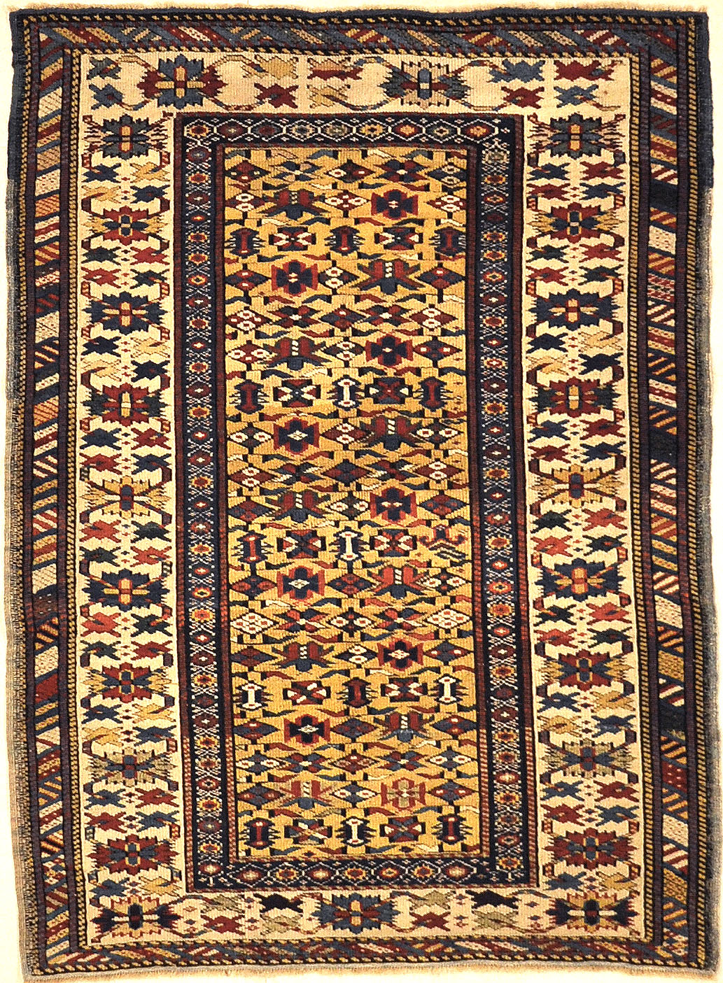 Antique Rare Gold Kuba Chichi Rug. A genuine authentic antique piece of carpet art sold by the Santa Barbara Design Center, Rugs and More.