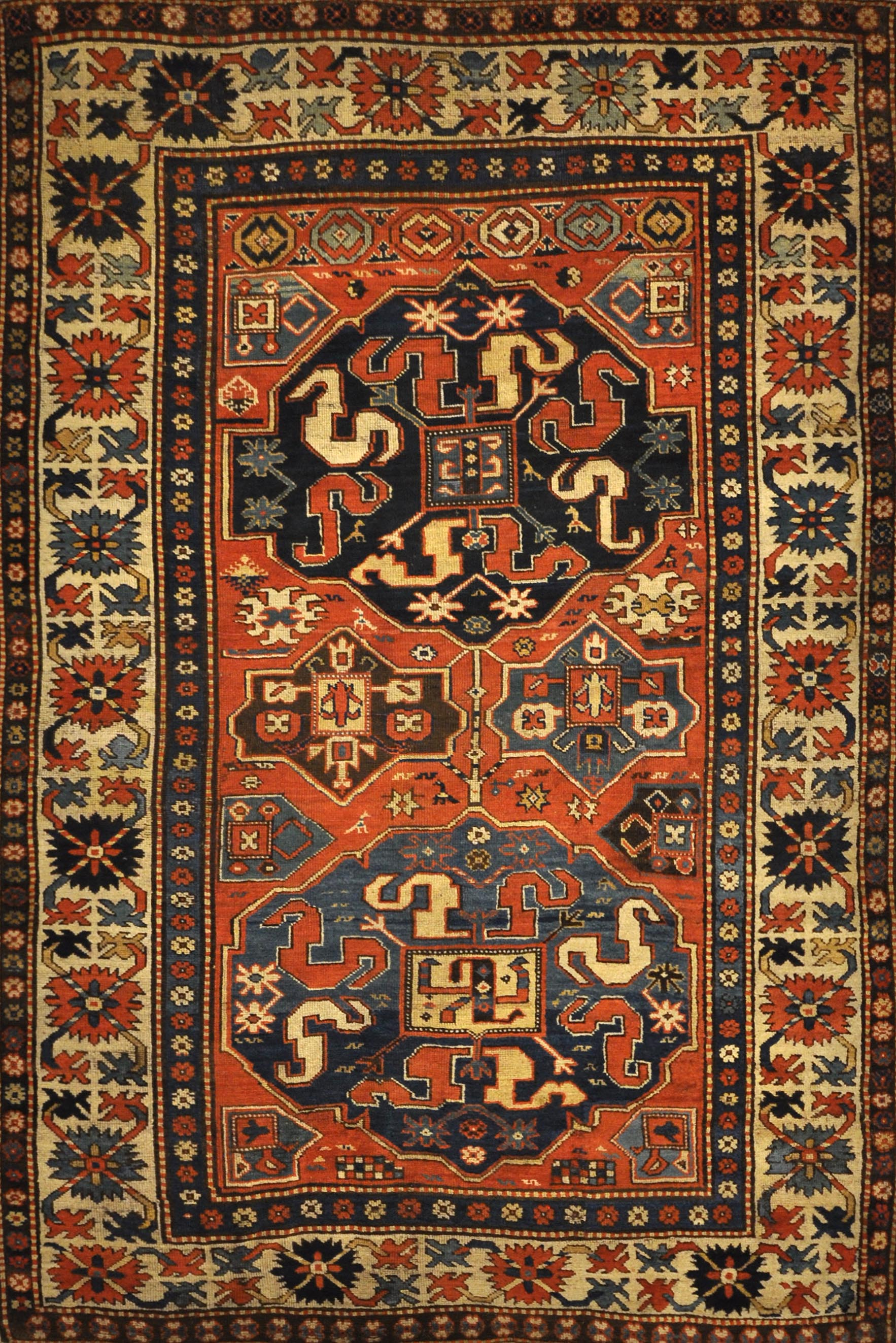 Antique Rare Cloudband Caucasian Chondzoresk Rug. A piece of genuine authentic antique woven carpet art sold by Santa Barbara Design Center Rugs More.