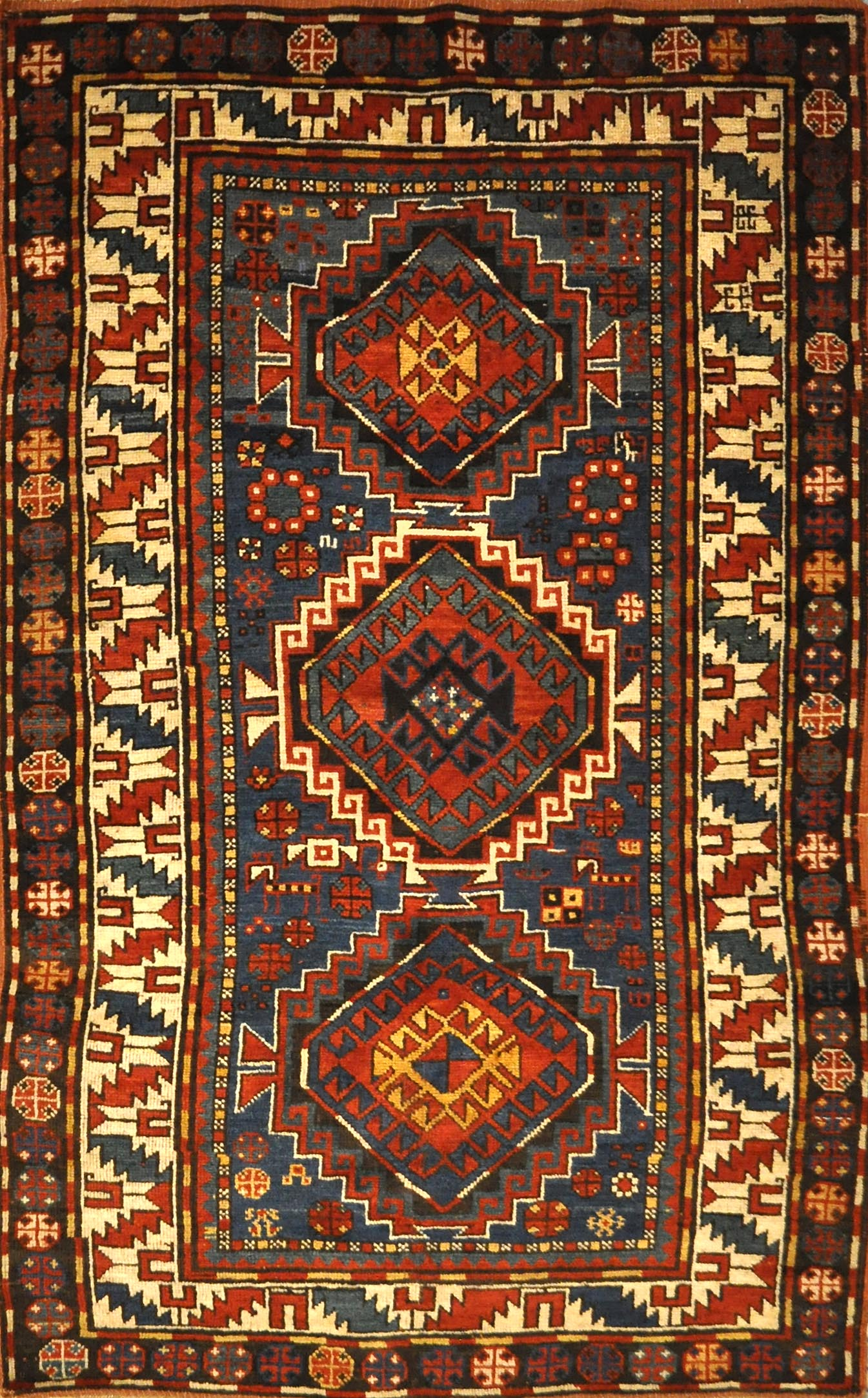 Antique Kazak Rug Circa 1880. A piece of genuine authentic antique woven carpet art sold by Santa Barbara Design Center, Rugs and More.