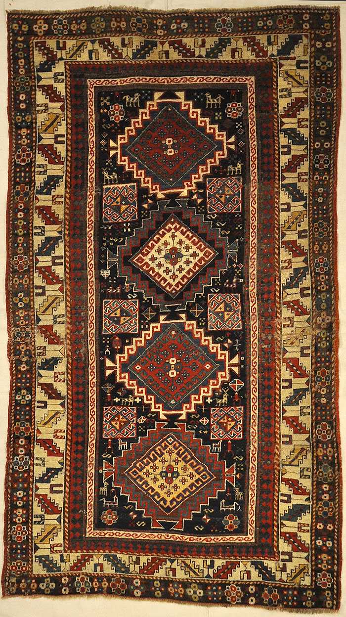 Caucasian Marriage Rug From 1880s. A piece of genuine antique woven carpet art sold by the Santa Barbara Design Center, Rugs and More.