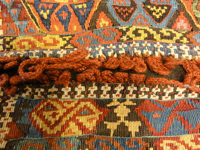 Small Bakhetiari Kelim Saddle Bag some metal threading throughout. Visit us Rugs & More in the Santa Barbara Design Center.