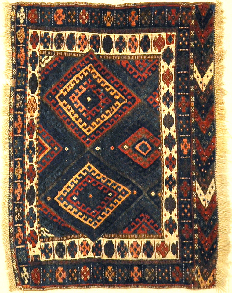 Kurdish Bagface Jaf Kurd. A genuine, antique piece of woven carpet art sold by Rugs & More in the Santa Barbara Design Center.