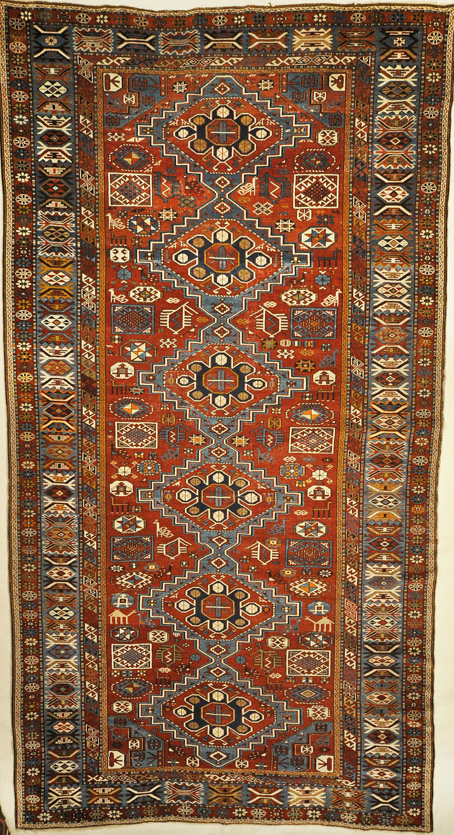 Fine Antique Shiwan long rug hand made of natural wool and organic dyes. Beautiful antique piece with animals and unique vibrant colors.