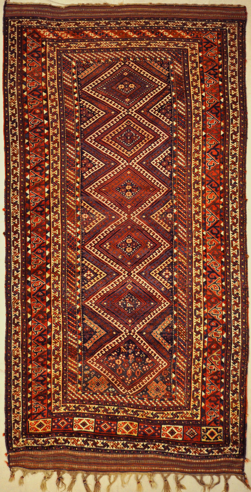 Antique Lori Persian Tribal Rug Circa 1880. A piece of genuine authentic antique woven carpet art sold by Santa Barbara Design Center Rugs and More.