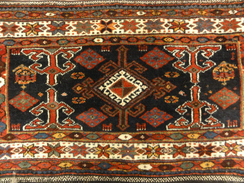 Kurdish Saddle Bag. A piece of genuine authentic antique woven carpet art sold by Santa Barbara Design Center, Rugs and More.