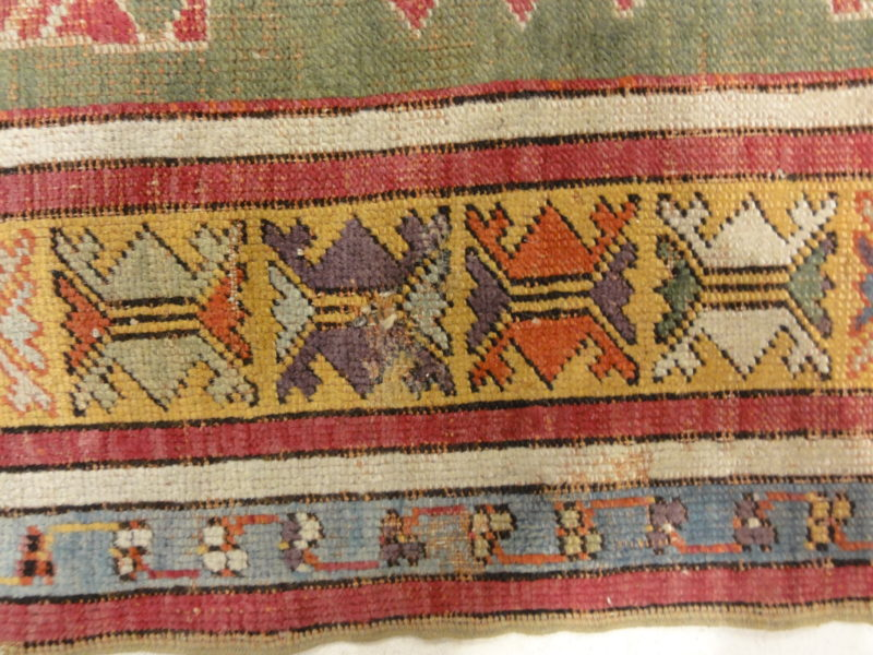 Antique Kirsehir Circa 18th Century. A piece of genuine authentic antique woven carpet art sold by Santa Barbara Design Center Rugs and More.