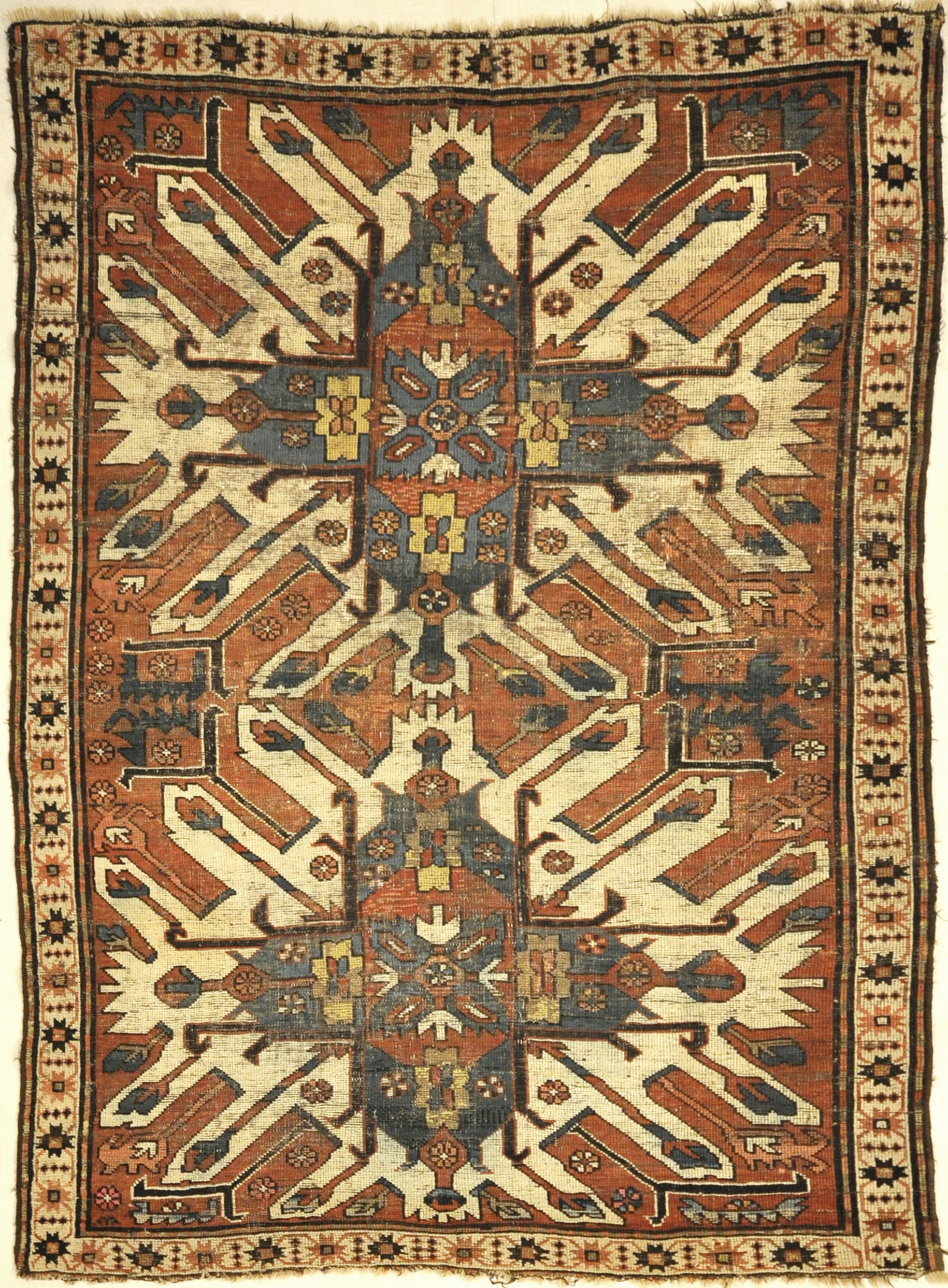 Antique Eagle Kazak Chelaberd Rug. A piece of genuine authentic woven carpet art sold by Santa Barbara Design Center Rugs and More.