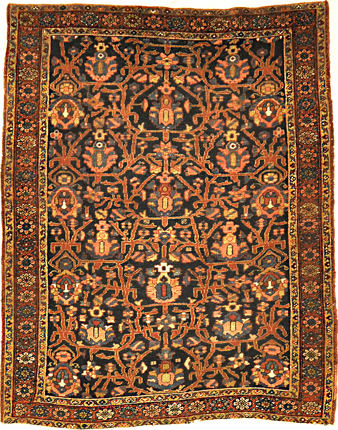 Antique Heriz Rug with a Unique Field. A piece of genuine authentic woven carpet art sold by the Santa Barbara Design Center, Rugs and More.