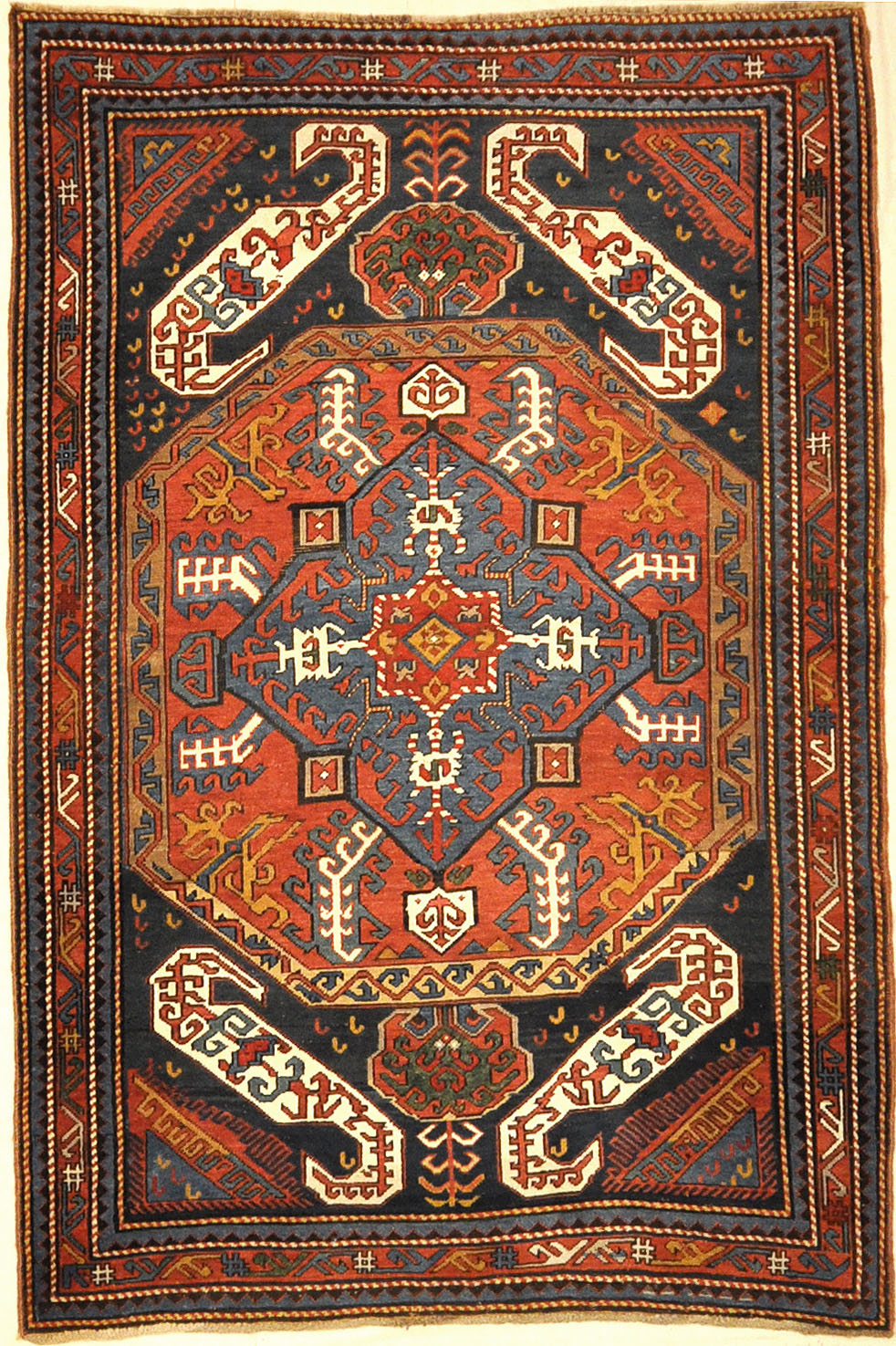 Antique Kazak Kasim Oushak ca 1875. A piece of genuine authentic antique woven carpet art sold by the Santa Barbara Design Center, Rugs and More.