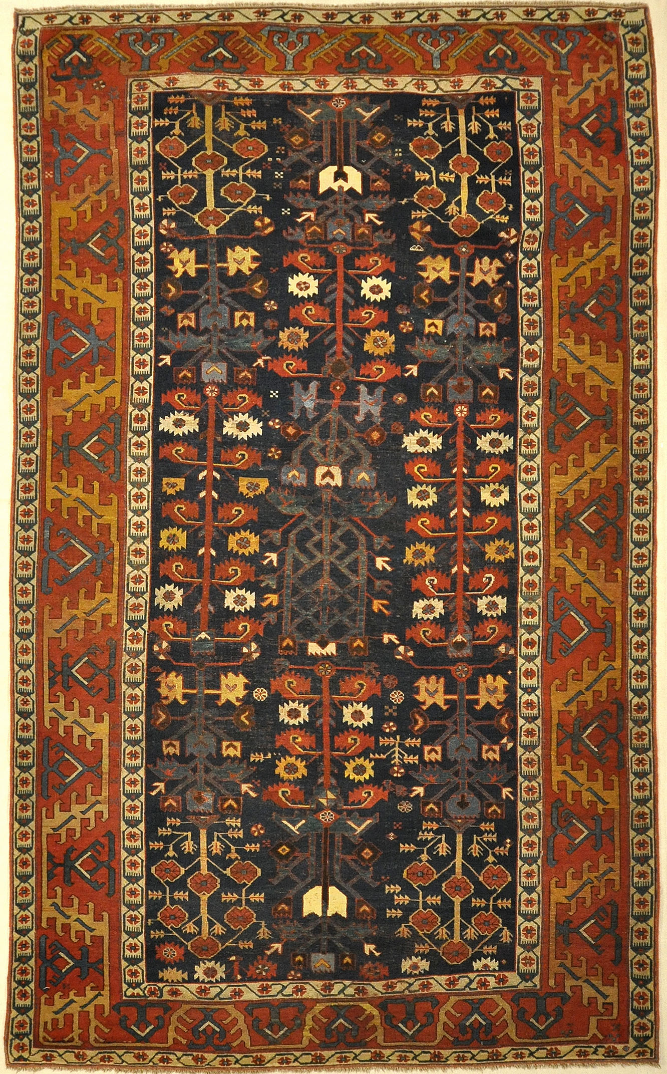 17th Century Pre-Proto Kurdish Shrub Carpet. A piece of genuine authentic antique woven carpet art sold by the Santa Barbara Design Center, Rugs and More.