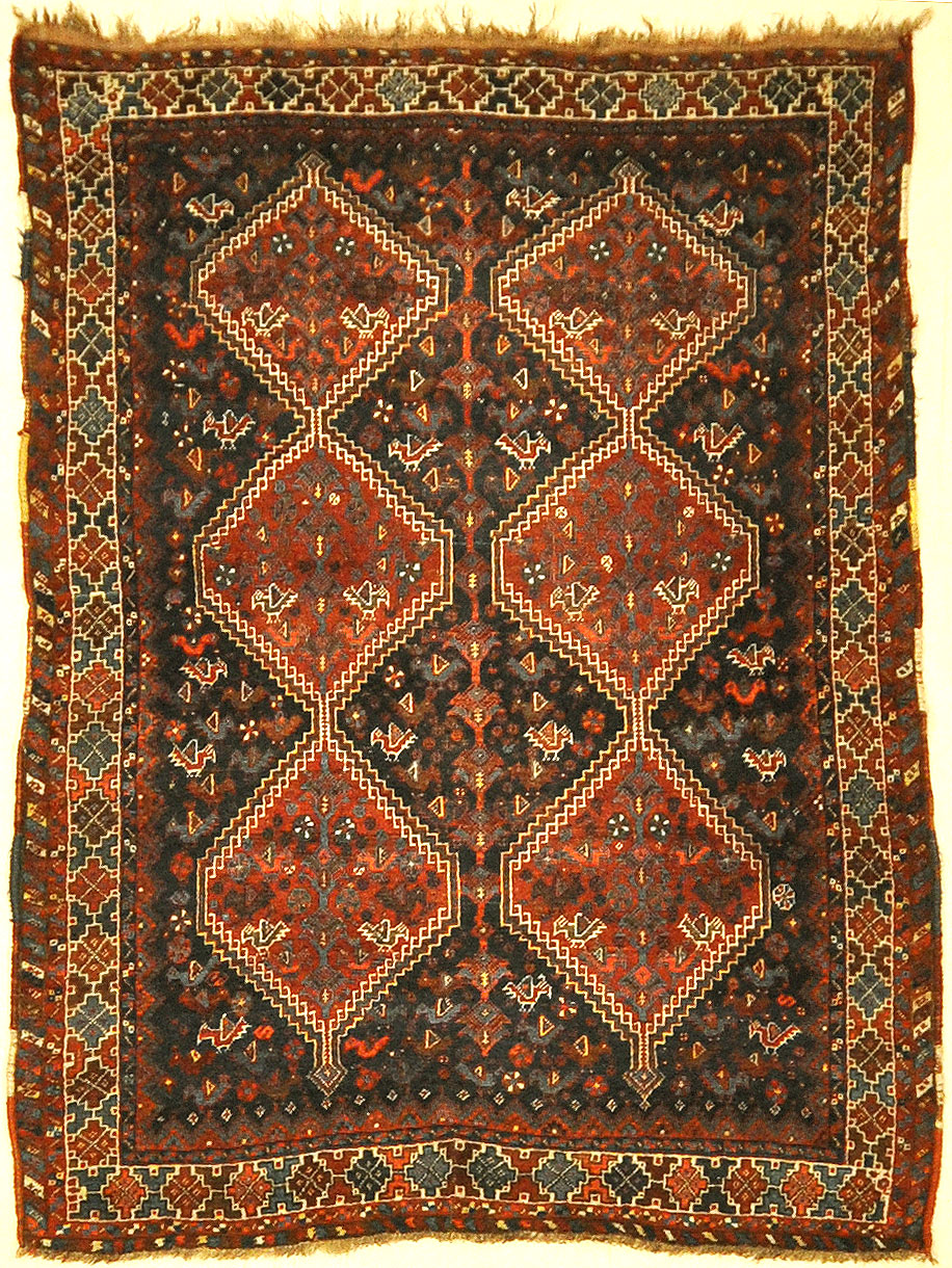 Antique Khamseh Chicken Rug. A piece of genuine authentic antique woven carpet art sold by Santa Barbara Design Center, Rugs and More.