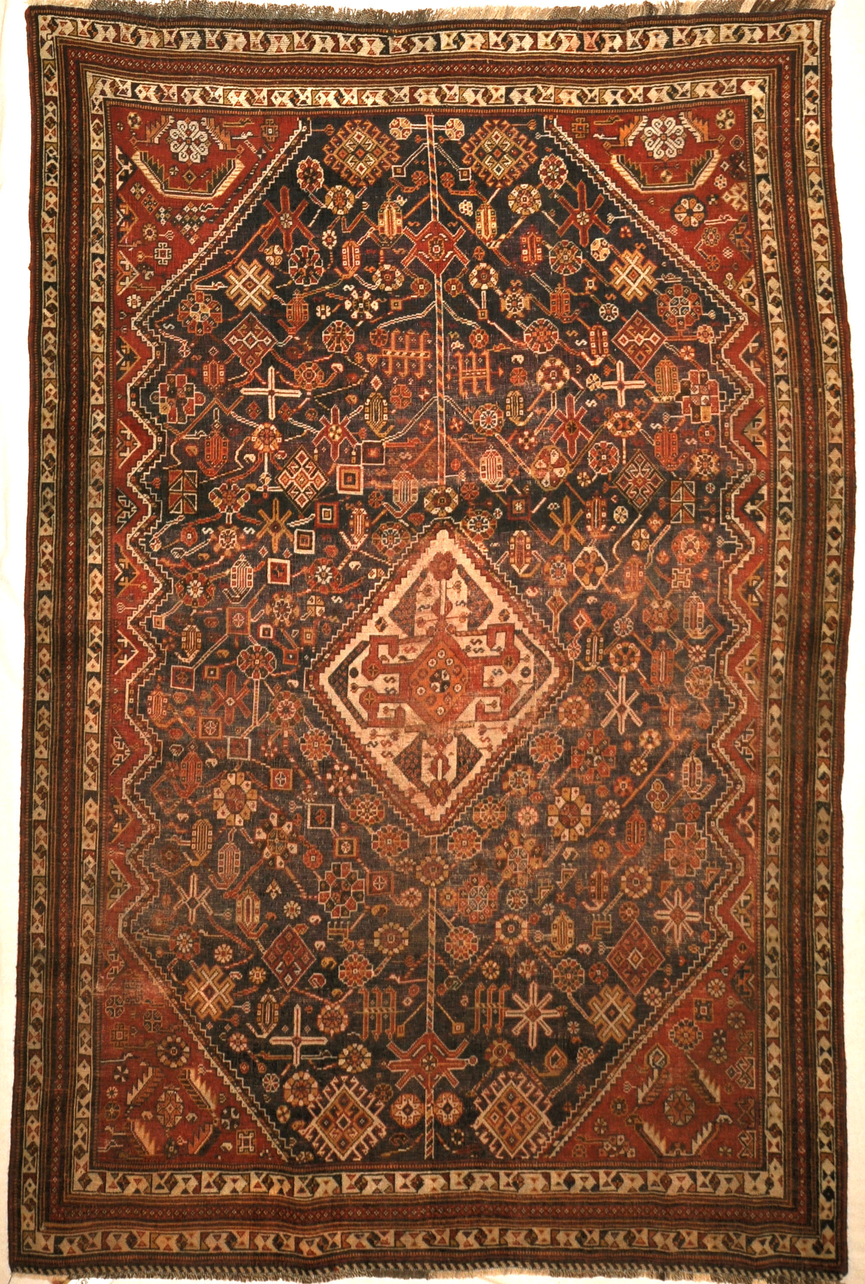 Antique Qashqai Rug. A piece of genuine antique authentic woven carpet art sold by the Santa Barbara Design Center, Rugs and More.