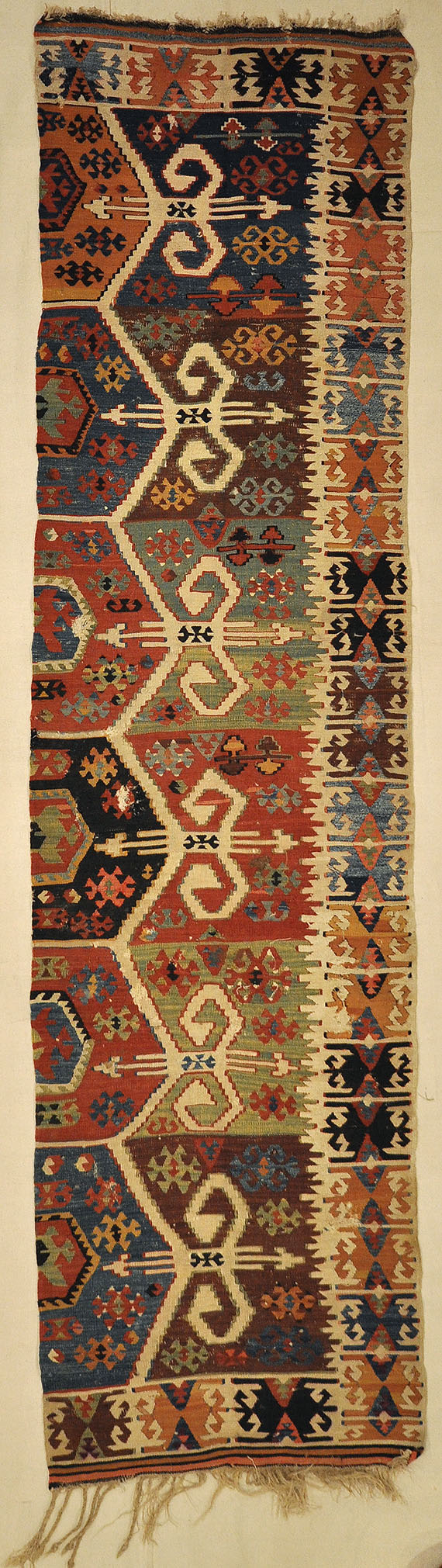Anatolia Goddess Turkish Kelim ca Late 1700s. A piece of antique woven carpet art sold by the Santa Barbara Design Center, Rugs and More in California.