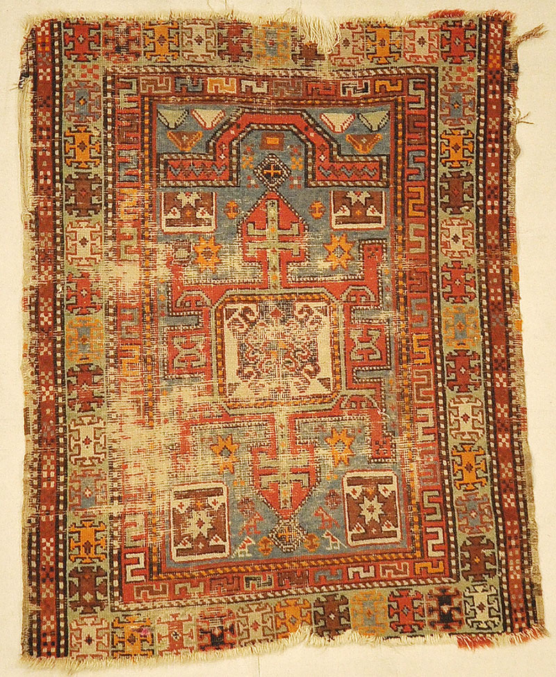Antique Shirvan Rug. A piece of antique woven carpet art sold by the Santa Barbara Design Center Rugs and More in Santa Barbara, California.