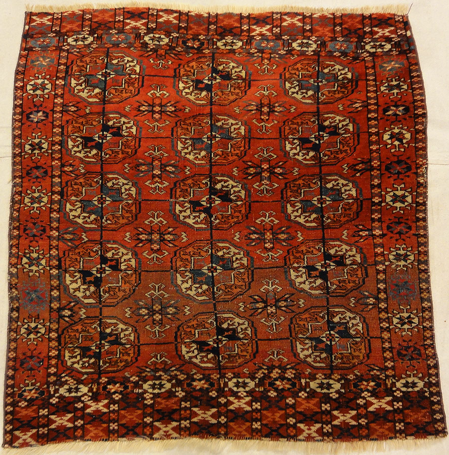 Fine Antique Tekke Bukhara Rug. A piece of genuine authentic woven carpet art sold by the Santa Barbara Design Center Rugs and More.