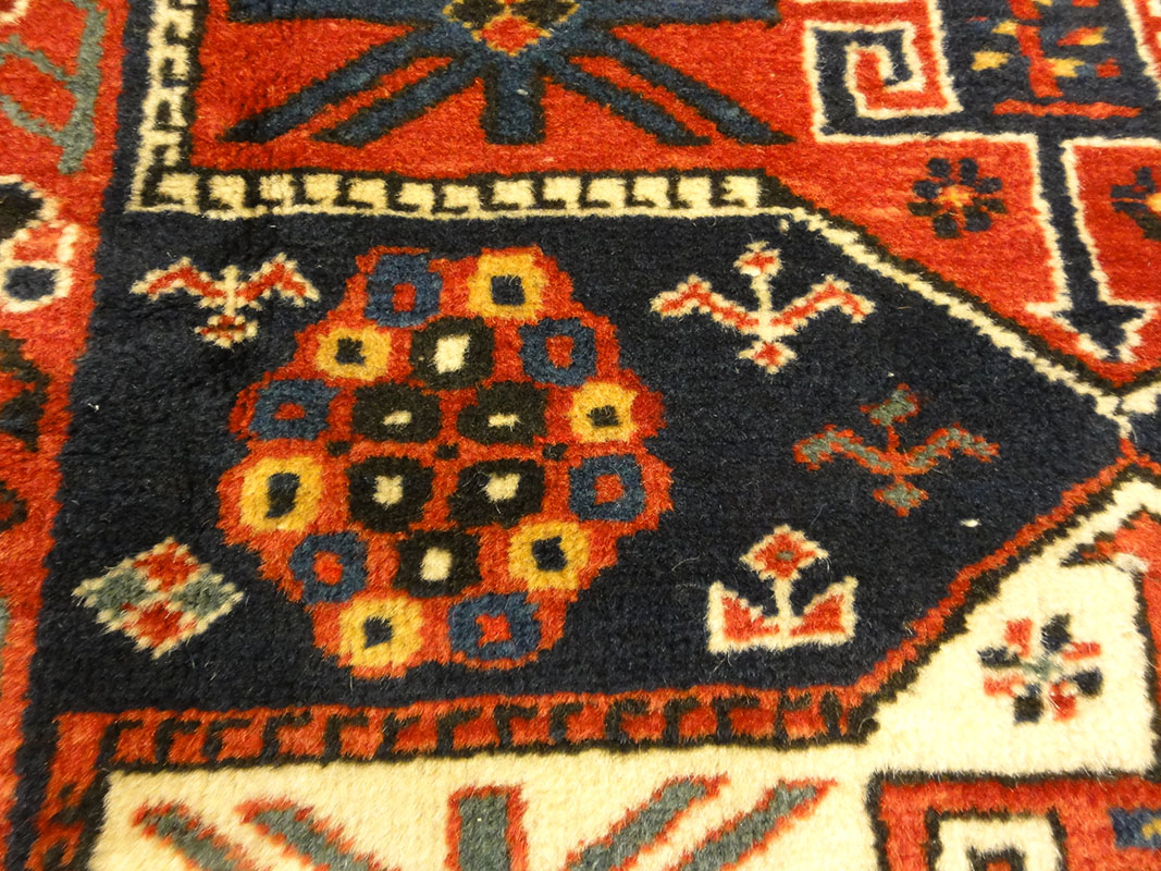 Amazing Caucasian Shirvan Baku Rug. An antique piece of woven carpet art sold by the Santa Barbara Design Center Rugs and More in Santa Barbara, California.