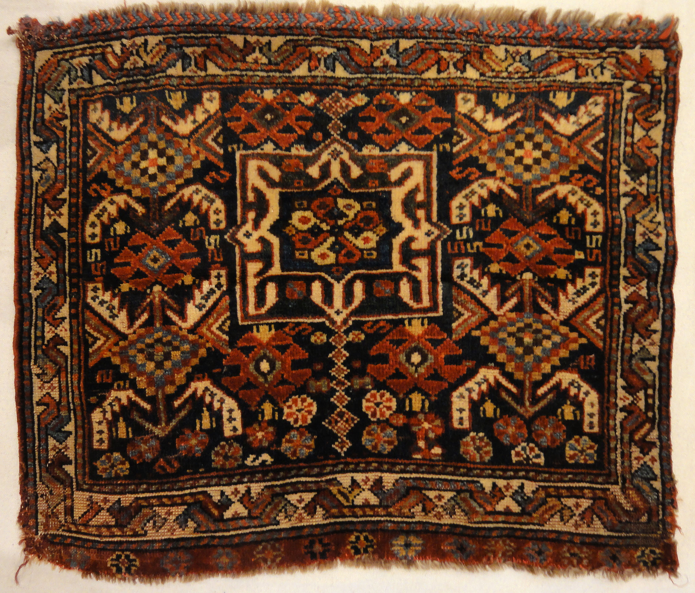 Antique Khamseh Southwest Persian Bagface. A piece of antique woven carpet art sold by Santa Barbara Design Center Rugs and More in Santa Barbara, CA.