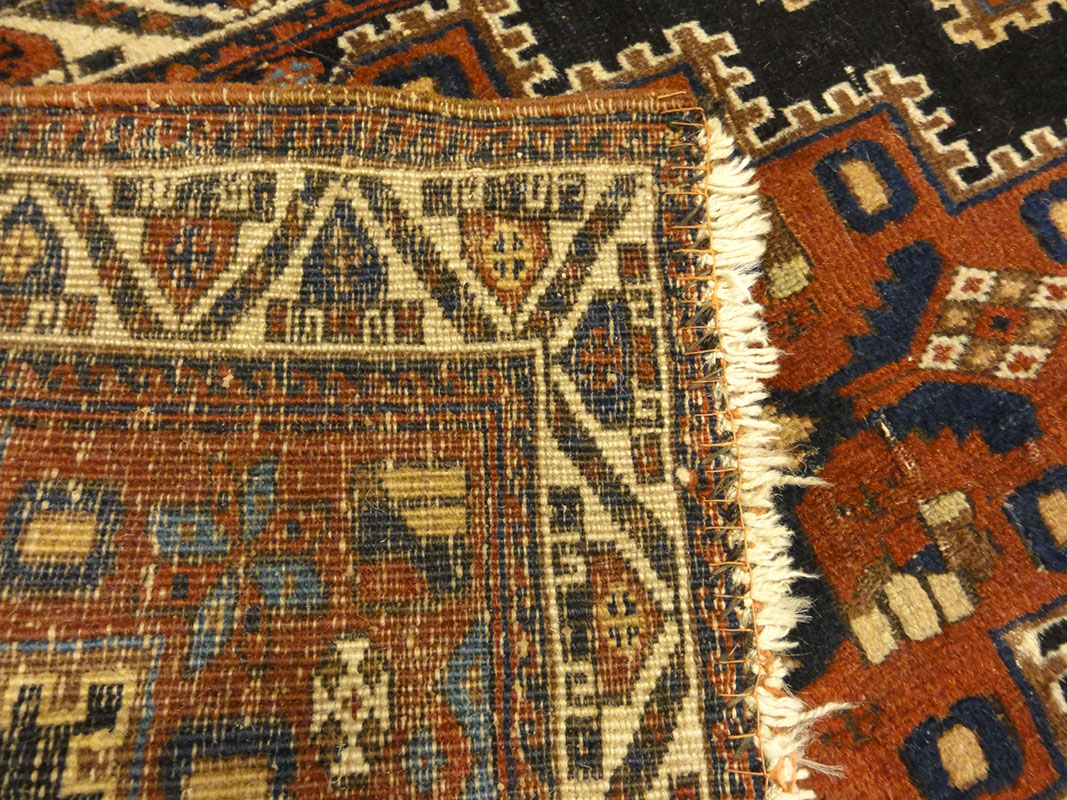 Fine Southwest Persian Afshar Bagface. A piece of woven carpet art sold by the Santa Barbara Design Center Rugs and More in Santa Barbara, California.
