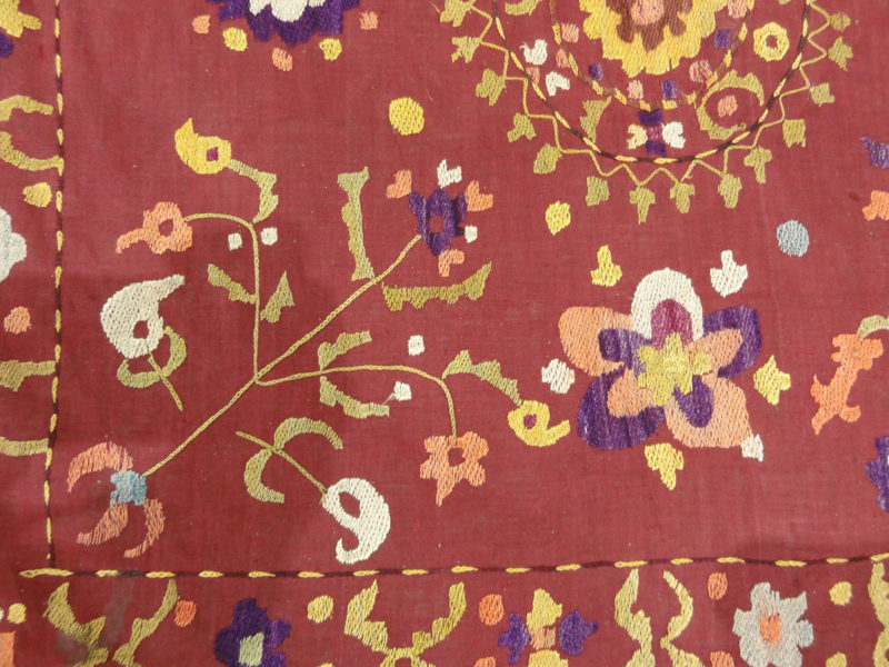 Antique Uzbek Turkestan Wool and Silk Suzani. A piece of wool and silk woven art sold by Santa Barbara Design Center Rugs and More in Santa Barbara CA.