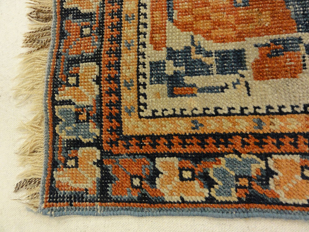 Antique Khamseh with Tribal Flowers. A piece of genuine woven carpet art sold at the Santa Barbara Design Center Rugs and More in Santa Barbara California.