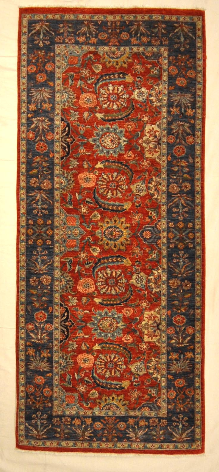 Fine Mughal Runner hand knotted of fine wool and organic dyes. These are the perfect colors to incorporate into your home.
