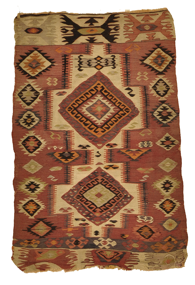 kilims feature muted colors and thin textures to allow the picture itself to stand out as the most noticeable feature on the rug's surface. Warm colors are often used as the primary hues throughout, though many kilims tend to balance the landscape by also applying cooler tones, which help create points of contrast that entice the viewer's responsiveness. 2'8 x 4'2
