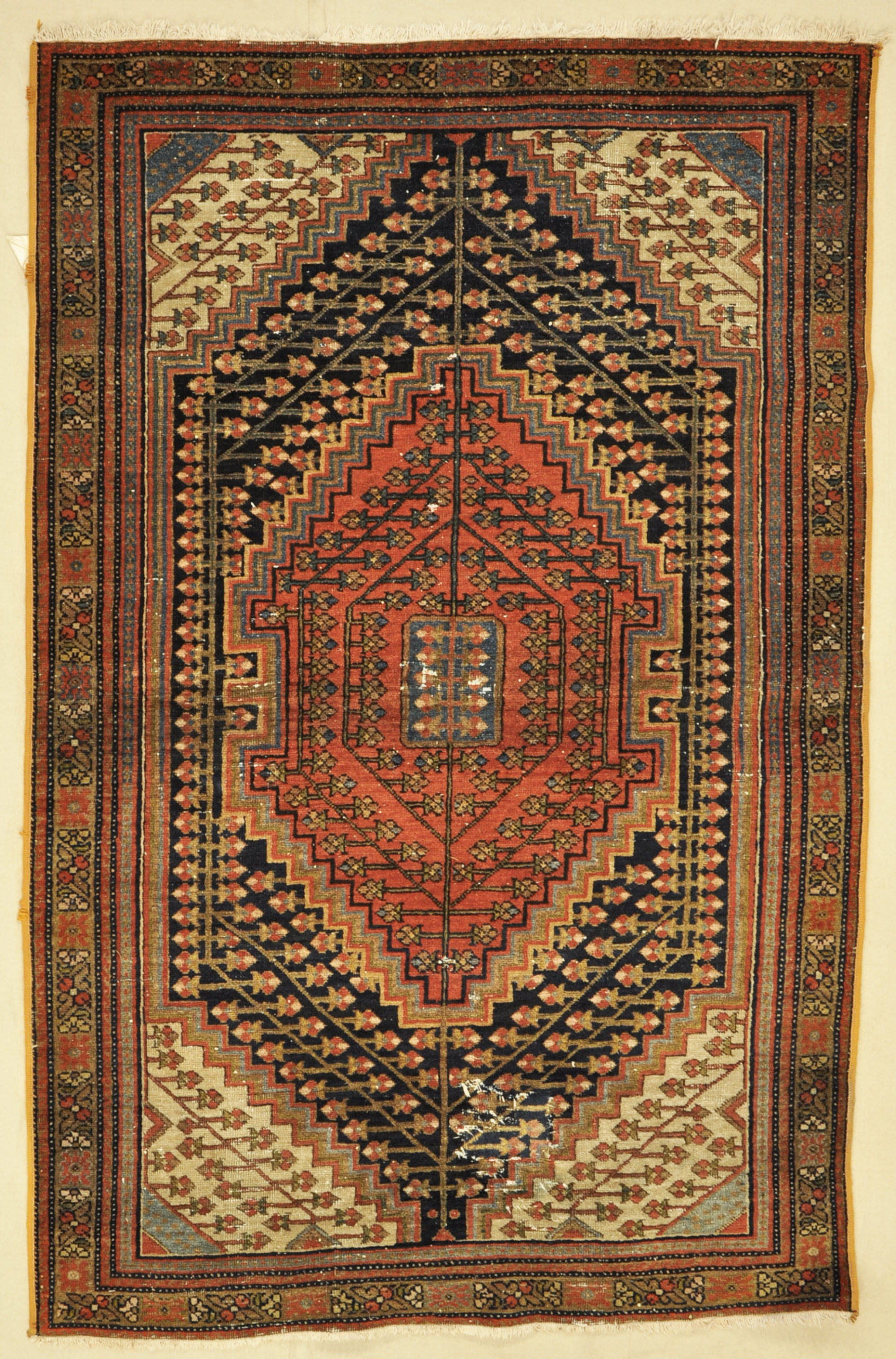 Antique rugs from the Malayer region constitute an important and distinctive group of Persian weavings. Technically they stand between those made in nearby Senneh and Hamadan. 4'5 x 6'9
