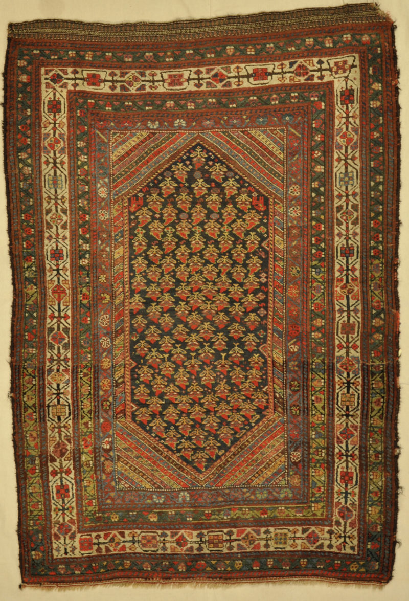 Antique Kurdish Rug hand made from natural wool and organic dyes 4'7 x 6'10